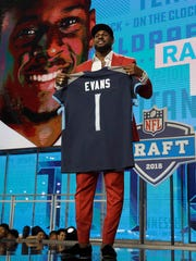 Alabama's Rashaan Evans poses with his Tennessee Titans jersey during the first round of the NFL football draft, Thursday, April 26, 2018, in Arlington, Texas. (AP Photo/David J. Phillip)