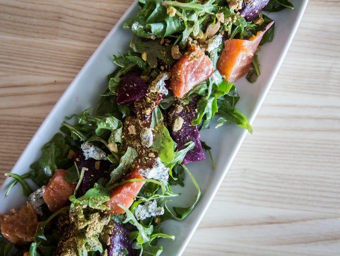 The Beet Salad with avocado crema, arugula, lemon vin,