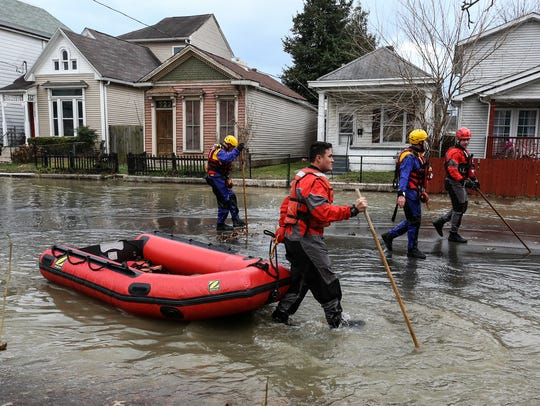 Rescue crews walked the streets around Shelby Park