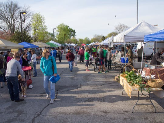 The Broad Ripple Farmers Market is crowded with people on opening day, May 3, 2014.