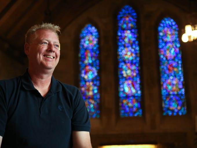 """Willet Hauser, a stained glass window repair company based in Minnesota, employee Alan Peterson inside the Duncan Memorial Chapel where he and Leo Tello will be spending the next 7-10 days replacing the protective coverings on the stained glass windows. """"Stained glass windows will usually last 50 to 100 years,"""" Peterson said. """"About 80 percent of what we're doing here is just replacing the protective coverings."""" April 3, 2014"""