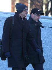 Aaron Troodler, right, enters the White Plains Federal