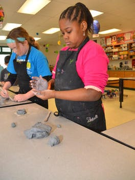 Students work on a coil pot in their fourth-grade art class at McCormick Elementary in Loveland. A proposal before the Ohio Board of Education would eliminate staffing requirements for art, music, library and other specialized teachers.