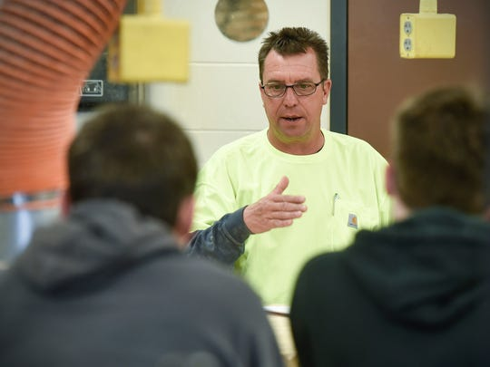 John Gazett, a job superintendent with W. Gohman Construction, talks to industrial-arts students on April 24, 2018, at Rocori High School in Cold Spring.