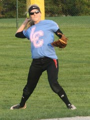 Erin Carpenter fires the ball into the infield during Monday's game against Stevenson.