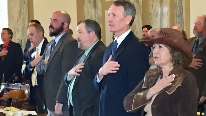 Rep. Lola Sheldon-Galloway, R-Great Falls, right, says the Pledge of Allegiance on Tuesday at the Montana House of Representatives convenes for a special session.