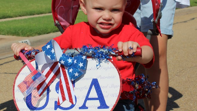 Tatum Terry, 2 going on 3, participates in his first parade in the Lone Star Ranch neighborhood event.