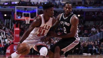 Bulls hold on to hand Spurs first road loss of season