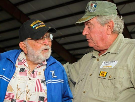 Vietnam veteran John Rogan, right,  takes time to thank
