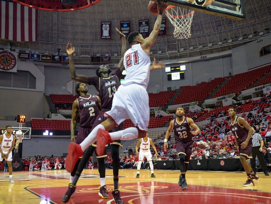 Shawn Long taking the ball to the basket as UL basketball
