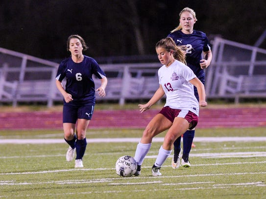 Emily Lejeune moves the ball down field as the No.