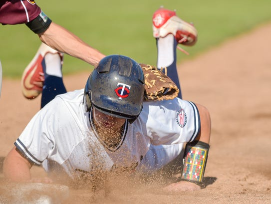 Josh Taylor dives back to first as the Teurlings Rebels