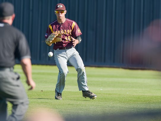 Right fielder Dustin King catches fly ball after one
