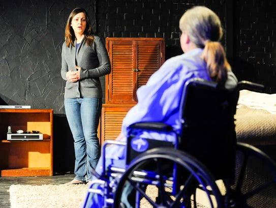 Actress Kayle Petitjean on stage at The Acadiana Repertory