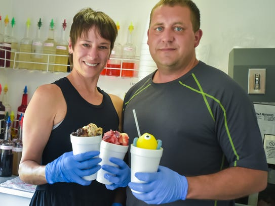 Brain Freeze owners Colby and Kristi Broussard serve