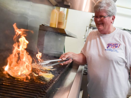 Sonnia Perry gets behind the grill at SHUCKS!