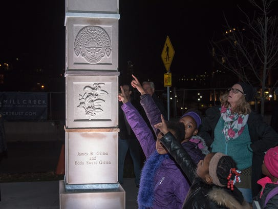 Children visit the Gateway Totem in Morristown, a project