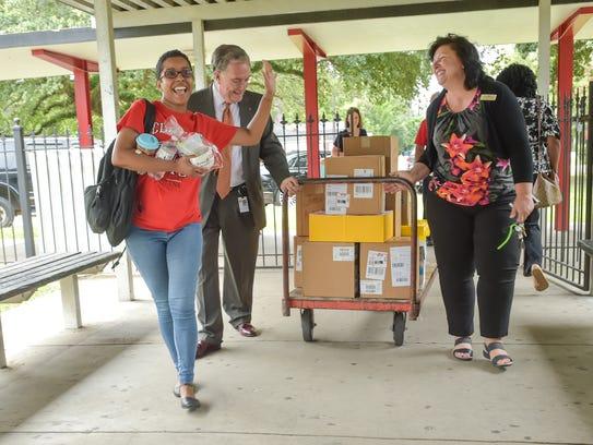 Home Bank adopts 10 Northside High School teachers