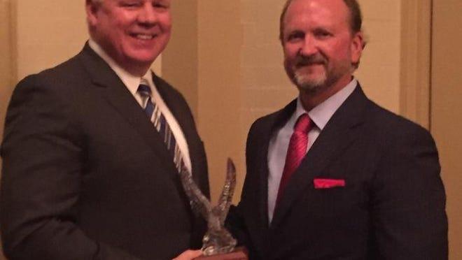 Chuck Kleckley receives the 2016 CHRISTUS Health Eagle Award.