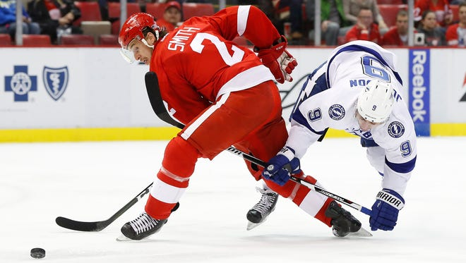 Detroit Red Wings defenseman Brendan Smith and Tampa Bay Lightning center Tyler Johnson collide in the third period on Nov. 15, 2016 in Detroit.