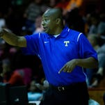 Tupelo's Head Coach Jeff Norwood gives instructions during the 3rd Annual Lighthouse Classic action held at Corinth High School on November 27, 2015.