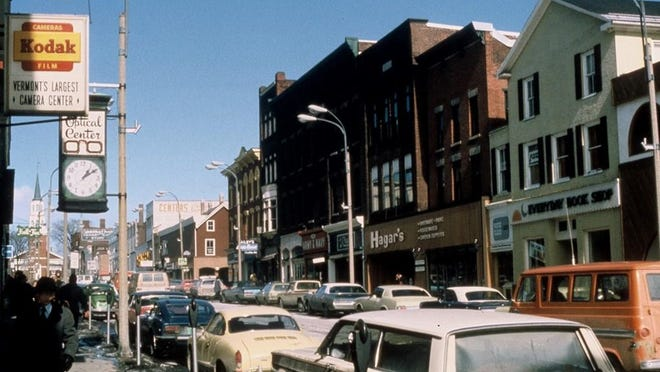 Cars parked on both sides of Church Street before the Marketplace was created.