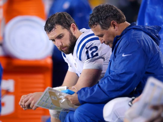 Indianapolis Colts quarterback Andrew Luck (12) sits on the bench during overtime action of an NFL football game Monday, Nov. 2, 2015, at Bank of America Stadium in Charlotte, North Carolina. Panthers won in sudden-death overtime 29-26.