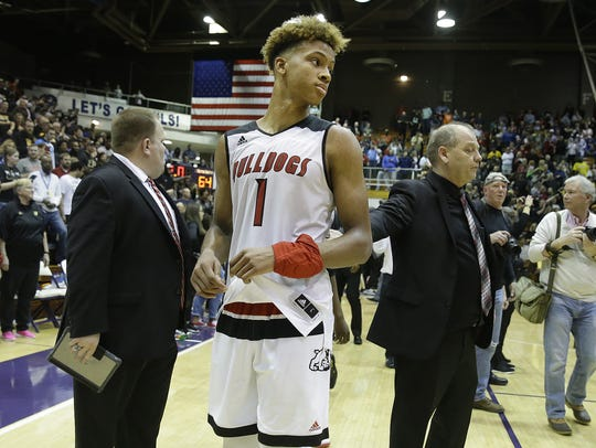 A dejected New Albany Bulldogs Romeo Langford (1) following