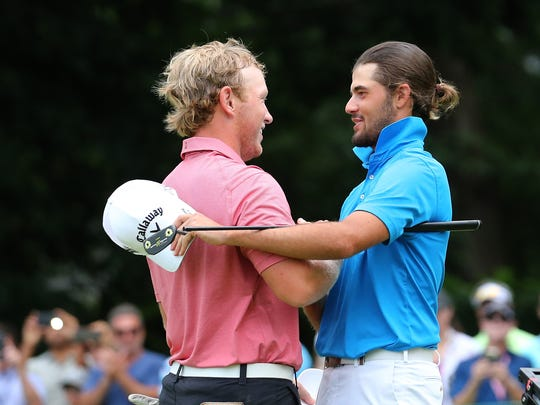 Curtis Luck congratulates Brad Dalke after winning the match, 6-4, to win the U.S Amateur.