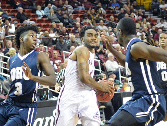 New Mexico State's Ian Baker gets ready to squeeze