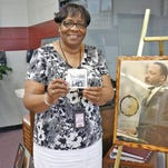 Laverne Greene-Leech, one of the women who desegregated Mississippi University for Women, holds a photograph of two other African-American freshmen who enrolled at the school in 1966.