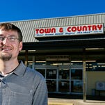 Devin Cooper, manager of Town & Country Supermarket in Anderson.