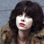 "Scarlett Johansson is a stunning but murderous alien in the sci-fi thriller ""Under the Skin."""
