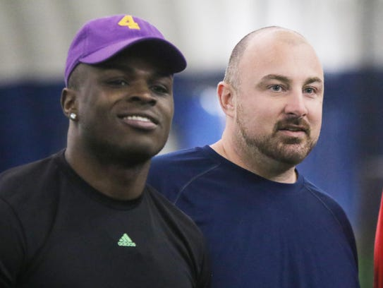 U-M assistant Chris Partridge, right, with Jabrill