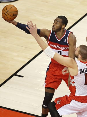 John Wall scored 31 points in 49 minutes for the Wizards.