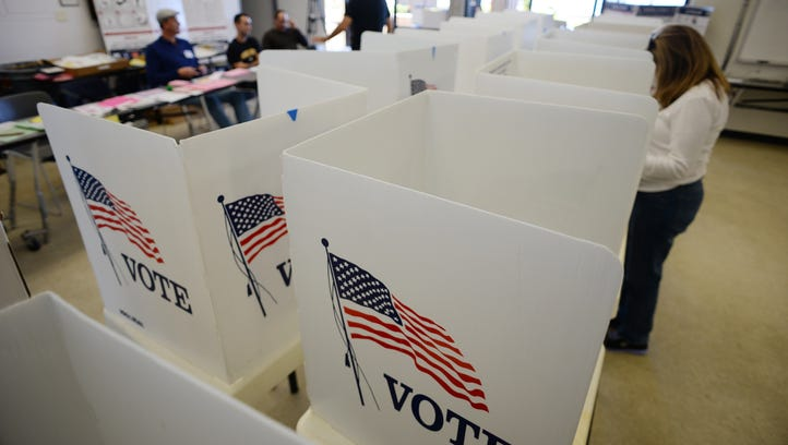 People vote at a polling place in Manhattan Beach, Calif., for the  midterm elections Nov. 4, 2014.