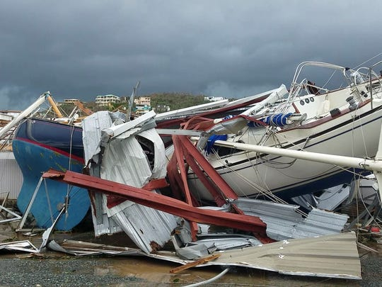 This image made from video shows damage from Hurricane Irma in St. Thomas, U.S. Virgin Islands, Thursday, Sept. 7, 2017. Hurricane Irma weakened slightly Thursday with sustained winds of 175 mph, according to the National Hurricane Center. The storm boasted 185 mph winds for a more than 24-hour period, making it the strongest storm ever recorded in the Atlantic Ocean. The storm was expected to arrive in Cuba by Friday. It could hit the Florida mainland by late Saturday, according to hurricane center models. (AP Photo/Ian Brown) ORG XMIT: XRE102
