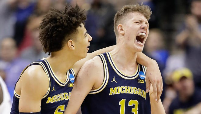 D.J. Wilson (5) and Moritz Wagner (13) have yet to decide if they'll enter the NBA draft or return to Michigan.