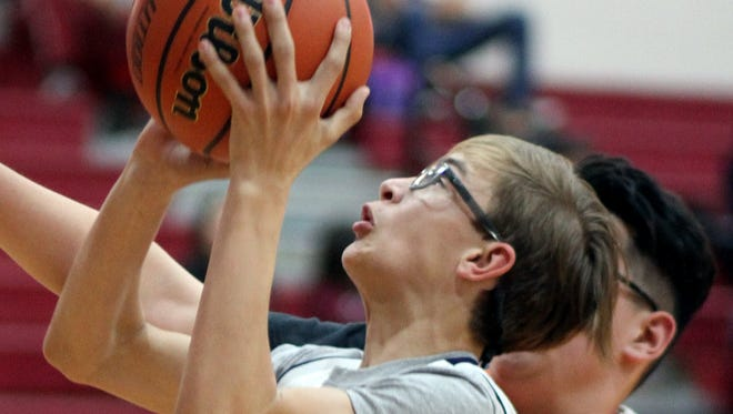 Wildcat Ivan Schultz powered up toward the basket during a 54-18 victory over Lordsburg by the seventh grade Wildcats on Thursday.