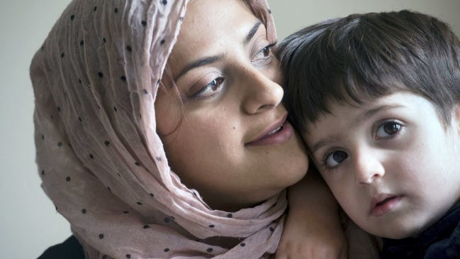 Durre Sharif, left, holds her son Zain, 3 at their home in Newberry Township. The holy month of Ramadan commemorates when Allah started to speak the verses of the Quran to Mohamad.