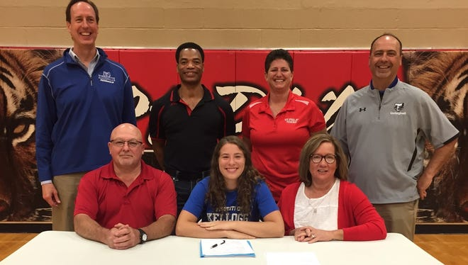 Kameron Haley (center) signs to play both volleyball and basketball at Kellogg Community College.