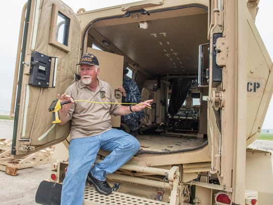 Lawrence McNinch, exercise site chief, explains the process of cutting up a Mine Resistant Ambush Protected vehicle Thursday.