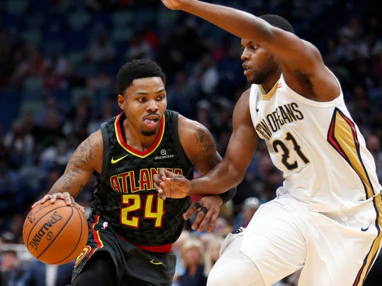 Atlanta Hawks guard Kent Bazemore (24) drives past New Orleans Pelicans forward Darius Miller (21) during the second half of an NBA basketball game in New Orleans, Monday, Nov. 13, 2017. The Pelicans won 106-105. (AP Photo/Tyler Kaufman)