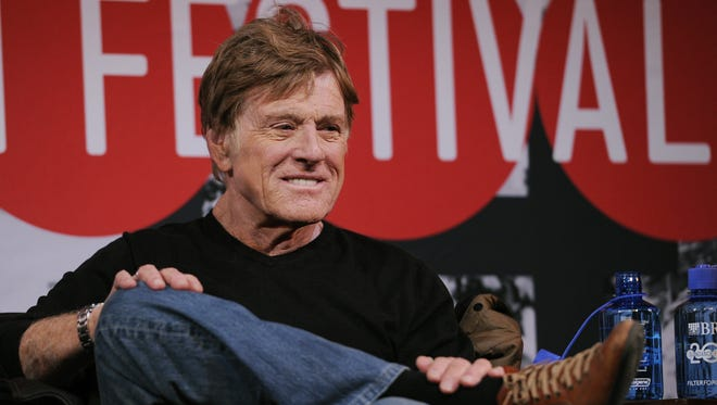 Robert Redford, founder and president of the Sundance Institute, looks on from the stage during the opening news conference of the 2014 Sundance Film Festival on Thursday, Jan. 16, 2014, in Park City, Utah. The independent film festival runs Jan. 16-26, 2014.