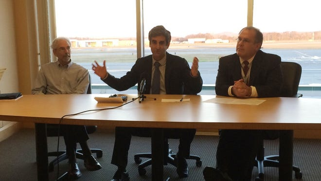 Burlington Mayor Miro Weinberger, center, announces a bond-rating upgrade for the city-owned airport Wednesday. With him at the airport is CAO Bob Rusten, left, and Aviation Director Gene Richards.