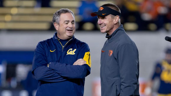 Nov 14, 2015; Berkeley, CA, USA; California Golden Bears head coach Sonny Dykes (left) speaks with Oregon State Beavers head coach Gary Andersen before the game at Memorial Stadium. Mandatory Credit: Kelley L Cox-USA TODAY Sports