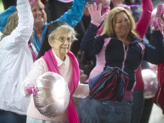 Sister Rebecca Endres dances along with the crowd during the filming of Agnesian HealthCare's Pink Glove Dance.