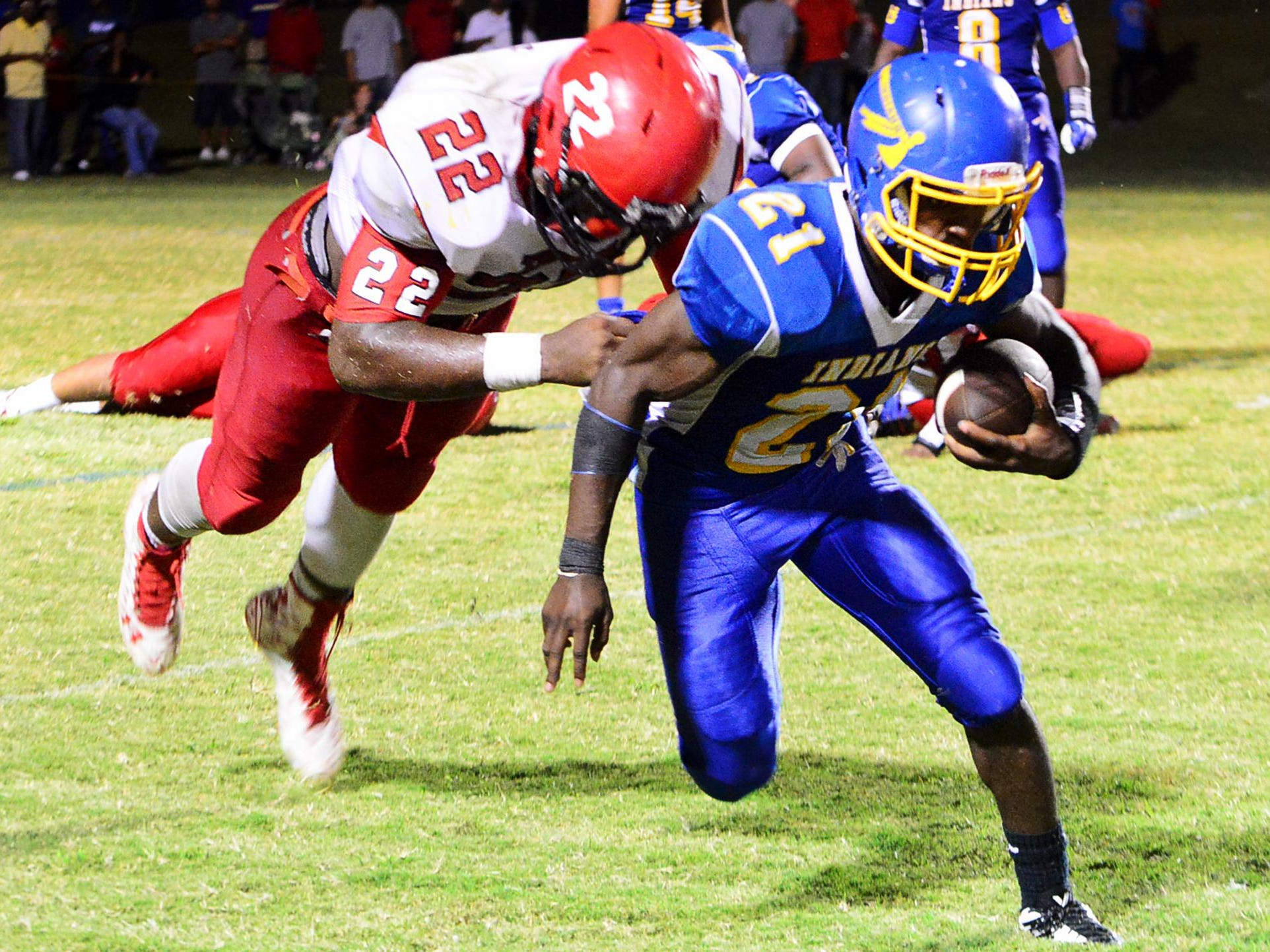 Lexington's Tariqious Tisdale grabs North Side's Darius Brown for a tackle, Friday at North Side.
