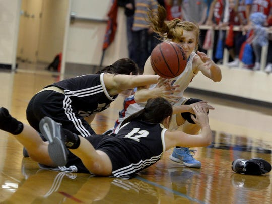 Gibson County's Allie Smithson fights for possession of a loose ball with Dresden's Alexis Osteen and Jacquline Ellis during their Region 7-A championship game Wednesday evening.