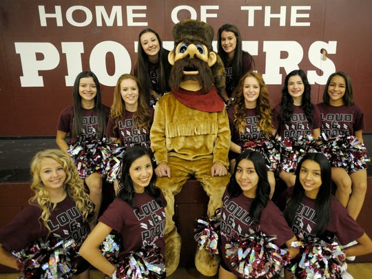 The Mt. Whitney High Cheer squad shows off the latest addition to the team, the official Mt. Whitney Pioneer mascot.